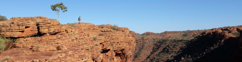 Man walking over Kings Canyon in the Australian Northern Territory